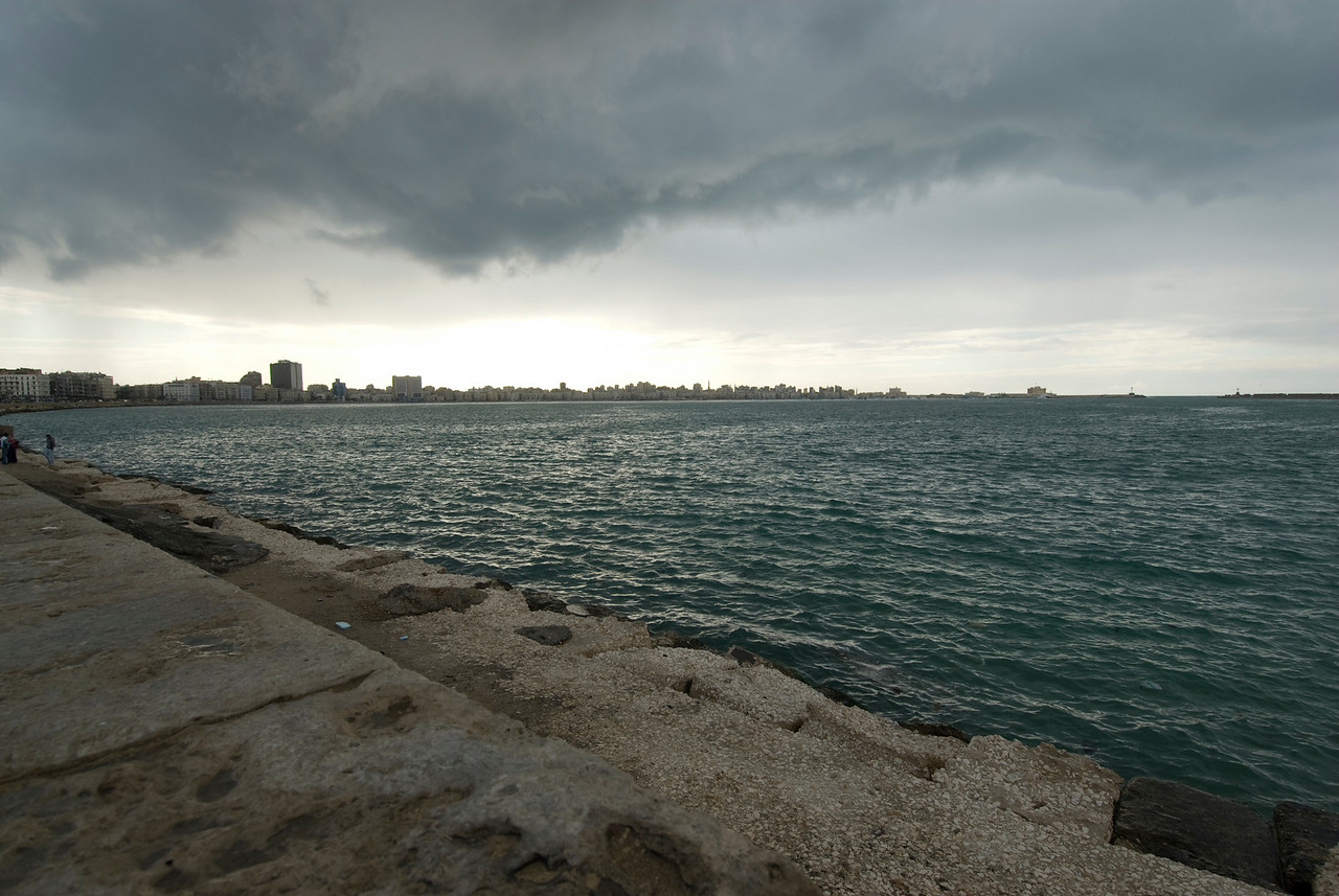 Heavy storm clouds above harbor front in Alexandria, Egypt