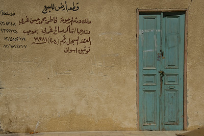 Arabic writings on wall near doorway - Aswan, Egypt