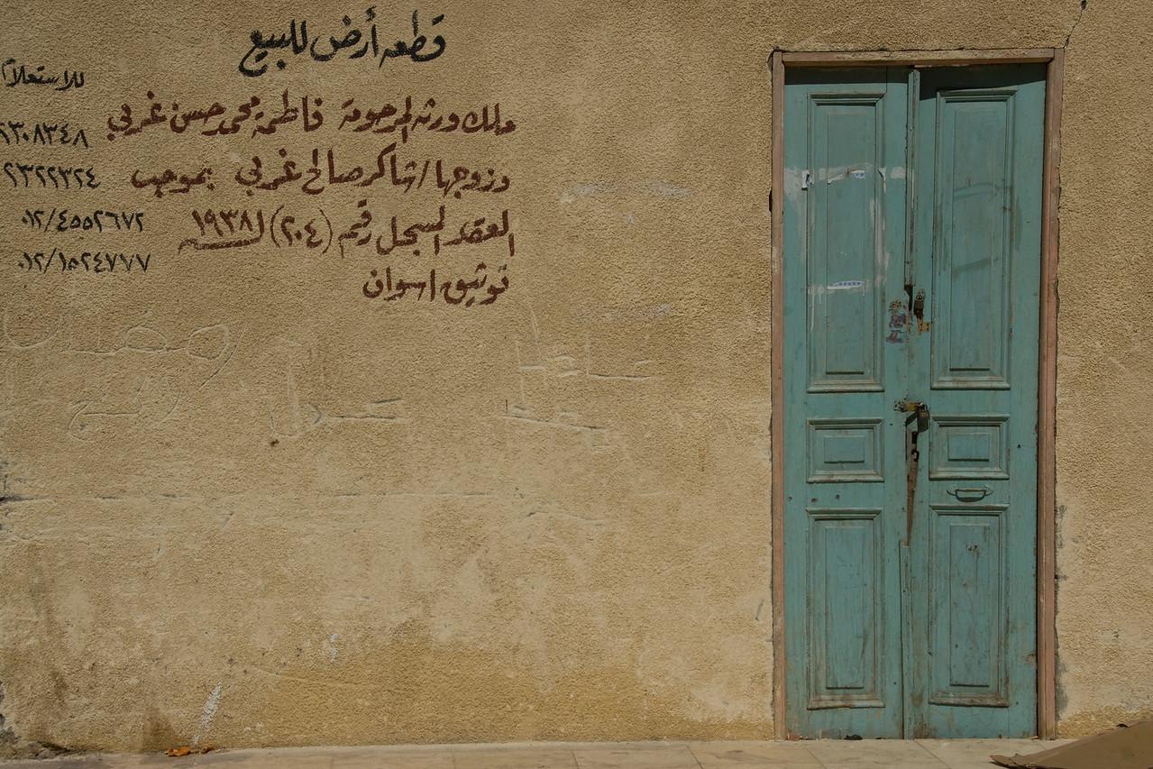 Arabic writings on wall near doorway - Aswan, Egypt