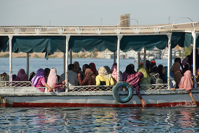 Women riding the ferry in Aswan, Egypt