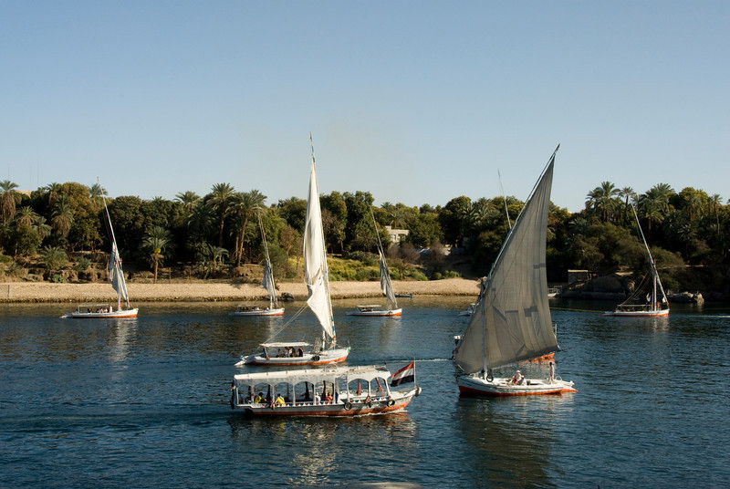 Felucca and ferry cruising the Nile River - Aswan, Egypt