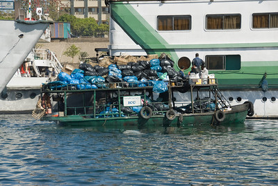 Garbage Boat on Nile River - Aswan, Egypt