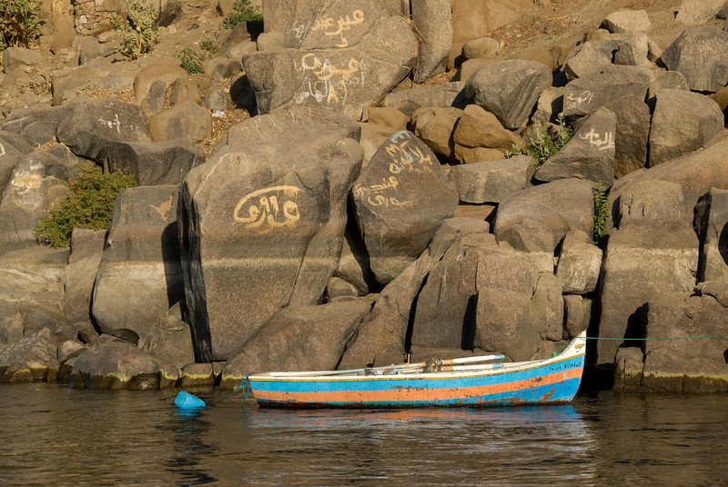 Boat and Graffiti Rock on Nile - Aswan, Egypt