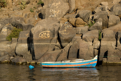 Boat and Graffiti Rock on Nile - Aswan, Egypt