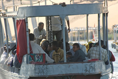 Locals riding the ferry along the Nile River - Aswan, Egypt