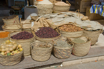 Baskets filled with dry goods at market - Aswan, Egypt