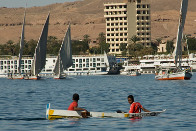 Boys riding a boat on Nile River - Aswan, Egypt