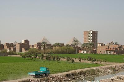 Pyramids towering above the neighborhood - Giza, Egypt