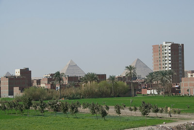 Pyramids towering over neighborhoods in Giza, Egypt