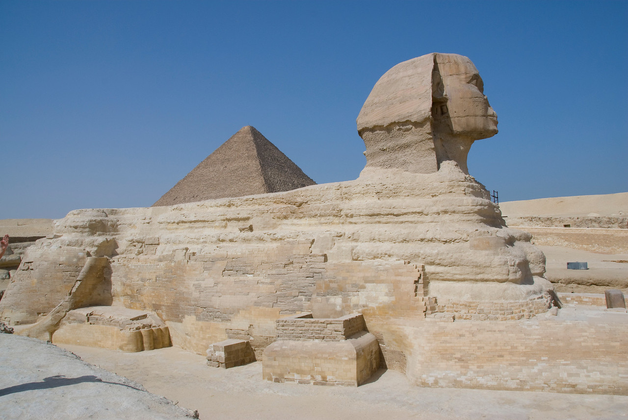 Side profile of the Sphinx with Pyramid peeking out - Giza, Egypt