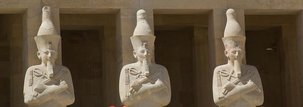 Three Pharaoh statues outside Hatshepsuts Temple - Luxor, Egypt