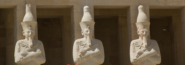 Three Pharaoh statues outside Hatshepsuts Temple - Luxor, Egypt
