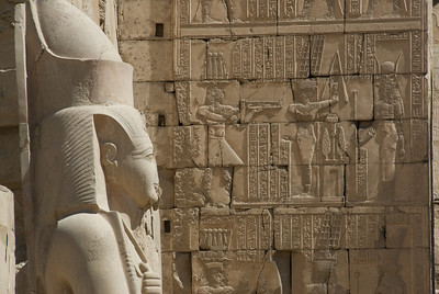 Side profile of Pharaoh statue and Heiroglyphs at Karnak Temple - Luxor, Egypt