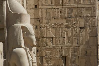 Side profile of Pharaoh statue and Heiroglyphs at Karnak Temple - Luxor, Egypt