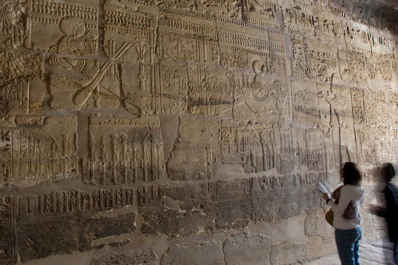 Tourists checking out ancient heiroglyphics at Karnak Temple - Luxor, Egypt
