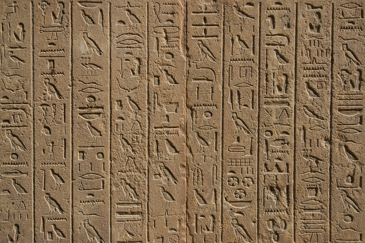 Close-up shot of ancient heiroglyphics at wall of Karnak Temple - Luxor, Egypt