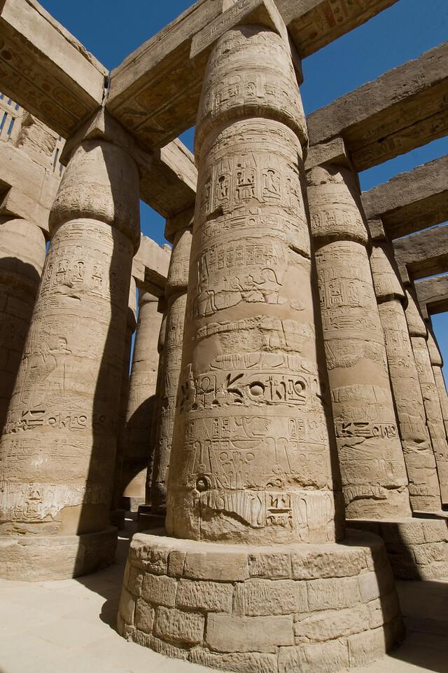 Looking up tall pillars of Karnak Temple - Luxor, Egypt