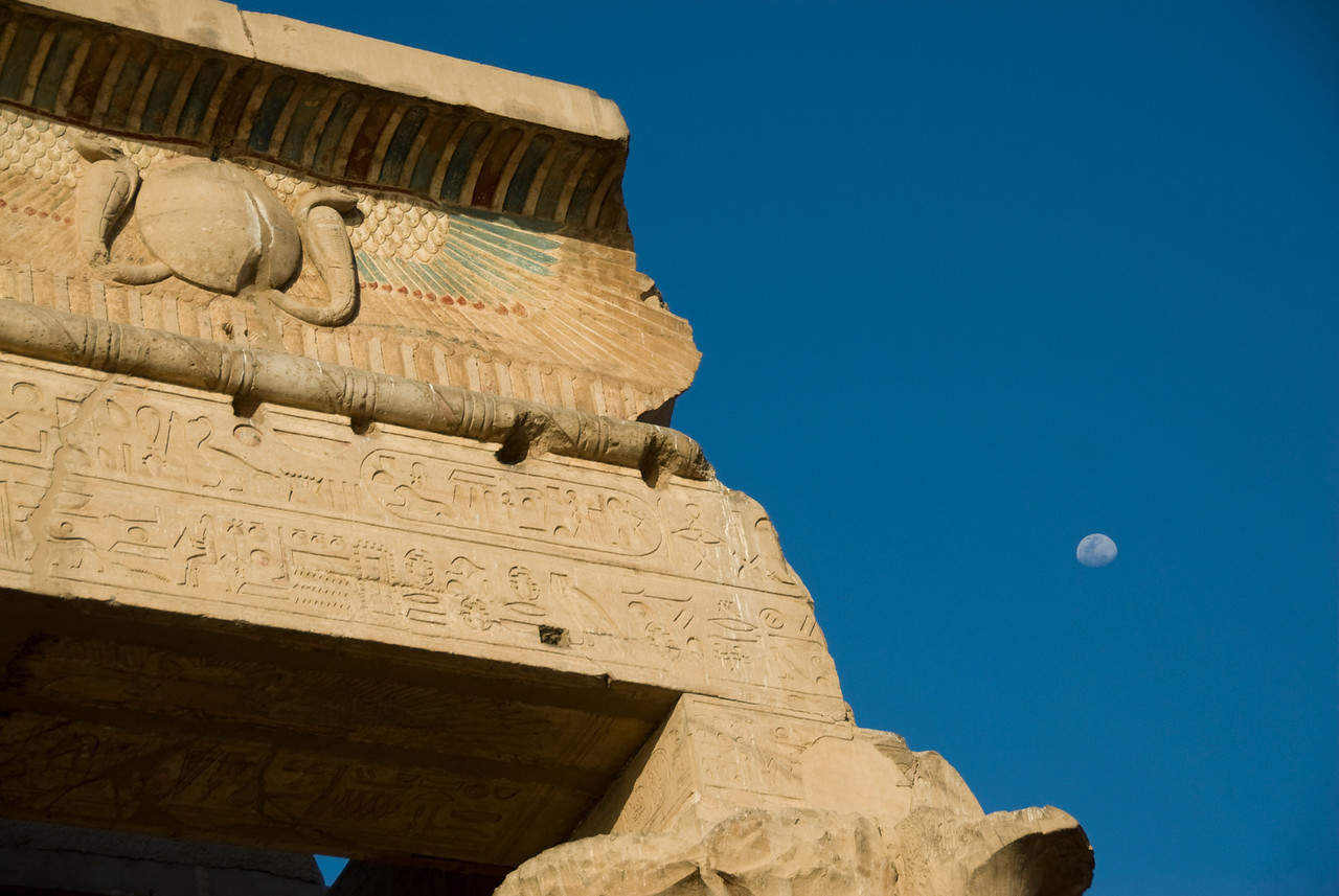 Isolated shot of the moon and temple carvings - Komombo, Egypt