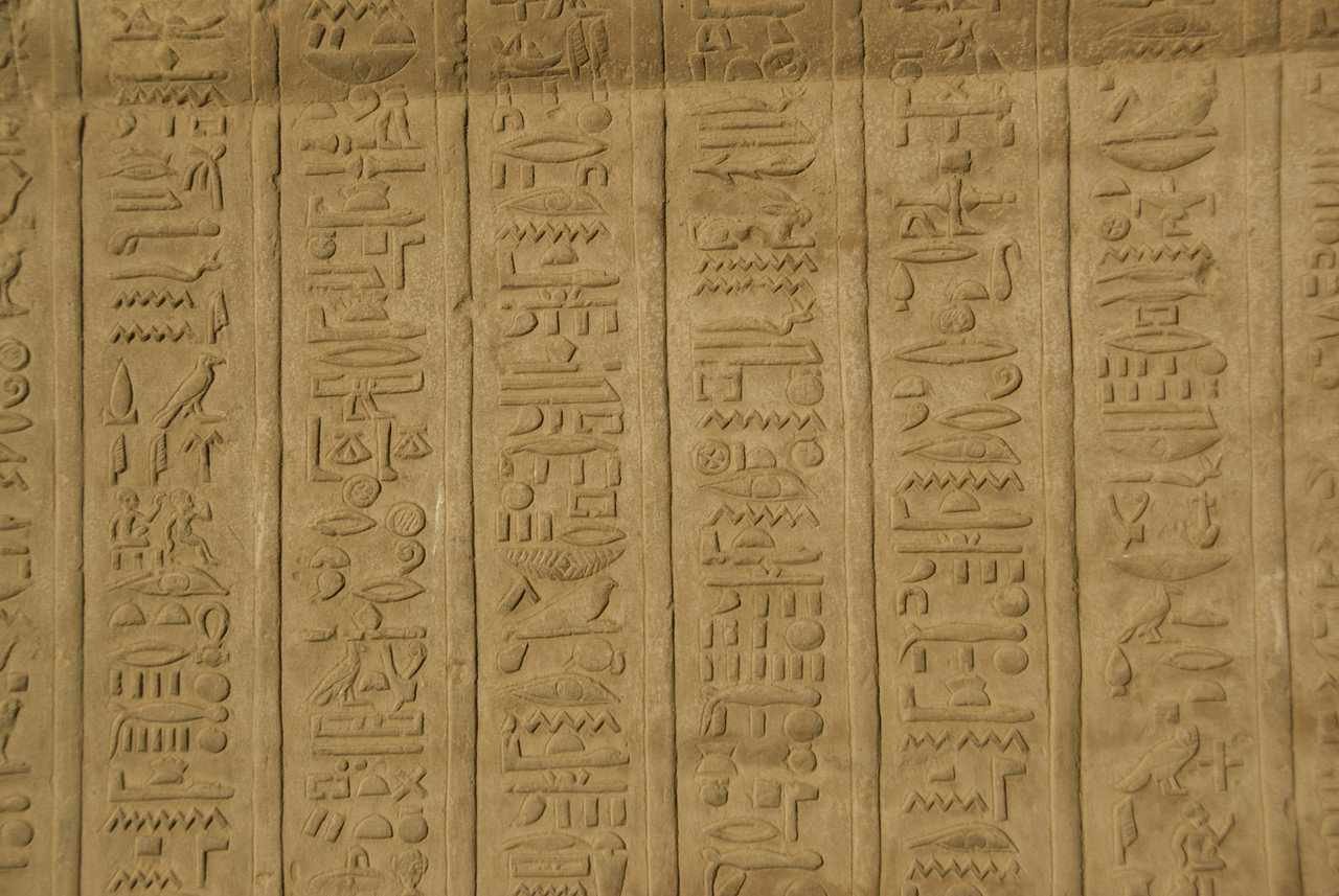 A section of wall filled with ancient heiroglyphics at Temple of Kom Ombo - Komombo, Egypt