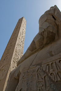 Obelisk and Statue inside Luxor Temple - Luxor, Egypt