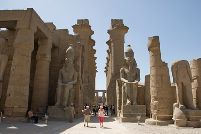 Statues and pillars inside ruins of Luxor Temple - Luxor, Egypt