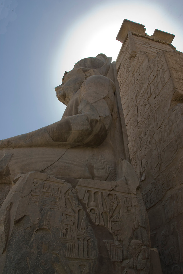 Looking up giant statues at Luxor Temple - Luxor, Egypt