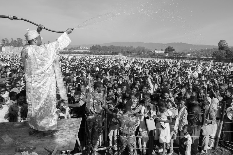 A Priest Sprays The Crowd, Jan Meda, Timkat