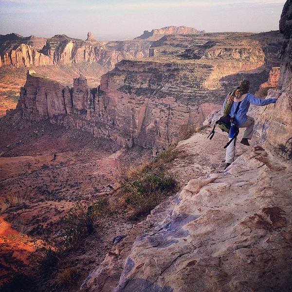 Audrey around the bend, on the edge of the cliffside, a few inches from a long way down (about 500m / 1600ft). Worth the terror, slowly facing fears. Backdrop = Gheralta, Ethiopia. via Instagram http://ift.tt/1n7MchY