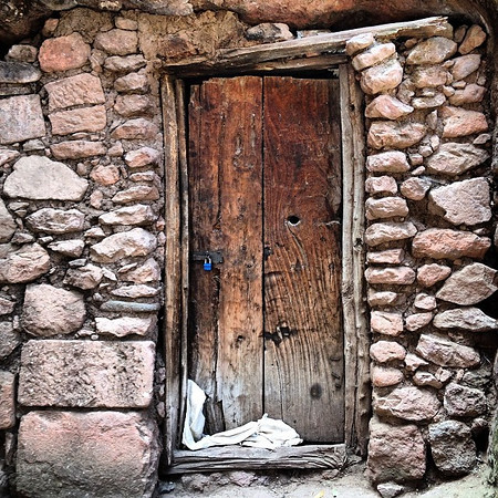 "Favorite ancient doorway candidate #31. Taken amidst the churches in the ""Earthly Jerusalem"" complex - Lalibela, Ethiopia. via Instagram http://ift.tt/1nRC4th"