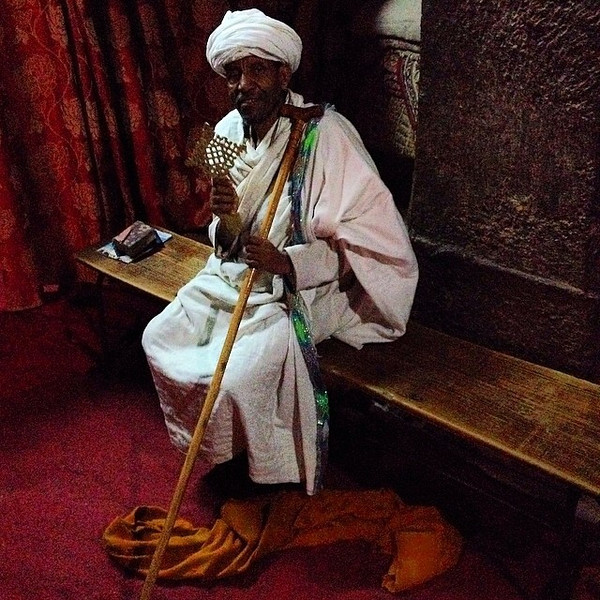 Busy blessing. The Ethiopian Orthodox priest inside the 12th c. Bet Danaghel (House of Virgins) - Lalibela, Ethiopia via Instagram http://ift.tt/QM7syD