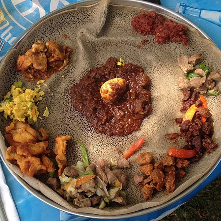 Our Easter Feast, Ethiopia style. A soshabie (like a thali) to break the Ethiopian Orthodox 55-day Lenten fast. A mix of tasty stews served atop injera, a spongy sourdough flatbread. #yum via Instagram http://ift.tt/1r4SGQ8