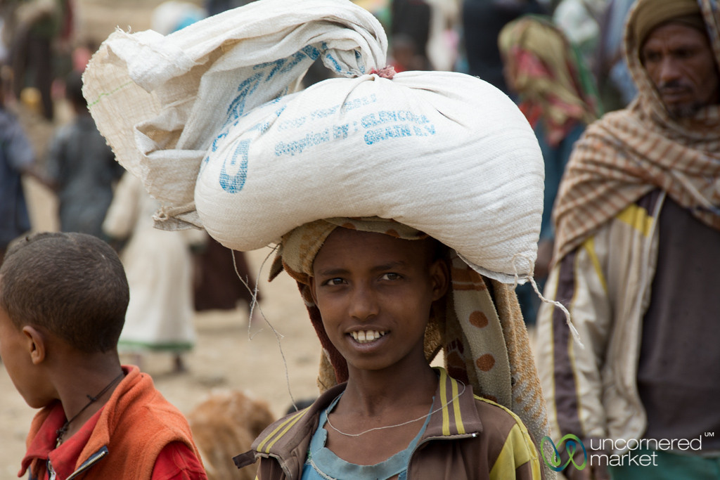 Ethiopian Boy with Bag on Head - Debark Market, Ethiopia