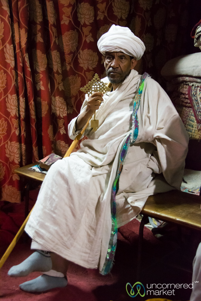 Ethiopian Orthodox priest inside the 12th century Bet Danaghel (House of Virgins) - Lalibela, Ethiopia