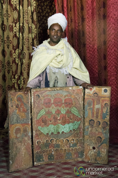 Antique Paintings and Ethiopian Priest at Yemrehana Kristos Church - Lalibela, Ethiopia