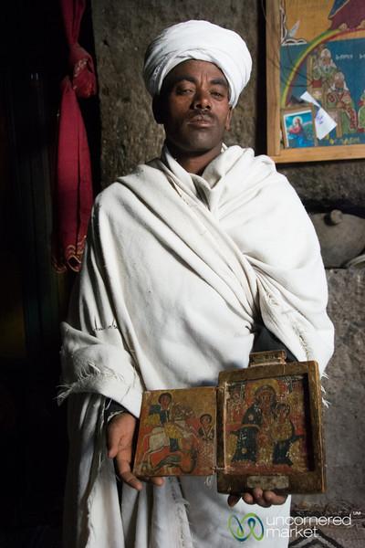 Ethiopian Priest with Religious Paintings - Lalibela, Ethiopia