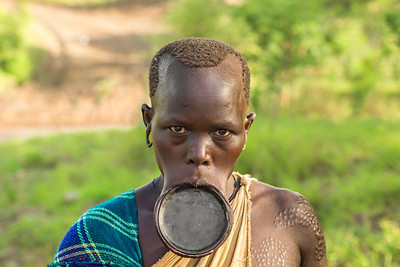 Woman from the African tribe Surma with big lip plate