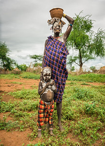 Woman from the african tribe Mursi with her baby, Ethiopia