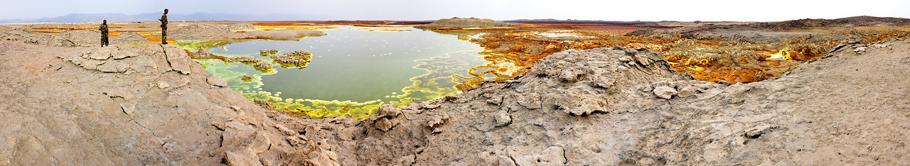 Two army soldiers look out over the sulfur fields.<br /> <br /> This is a 16-shot panorama stitched together in CS3.<br /> <br /> Location: Dallol, Denakil Depression, Ethiopia<br /> <br /> Lens used: 24-105mm f4.0 IS