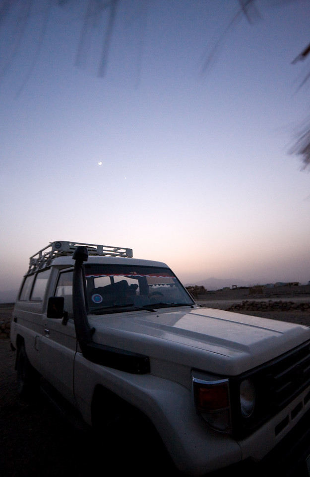 My chariot for this run into the wasteland, a 1984 Toyota Landcruiser, parked outside our hut for the night.<br /> <br /> Location: Hamd Ela, Denakil Depression, Ethiopia<br /> <br /> Lens used: 10-22mm f3.5-4.5