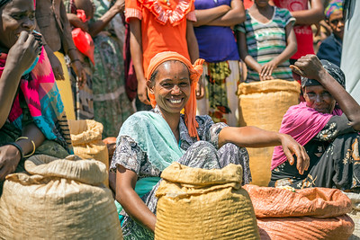 Ethiopian woman selling crops in a local crowded market