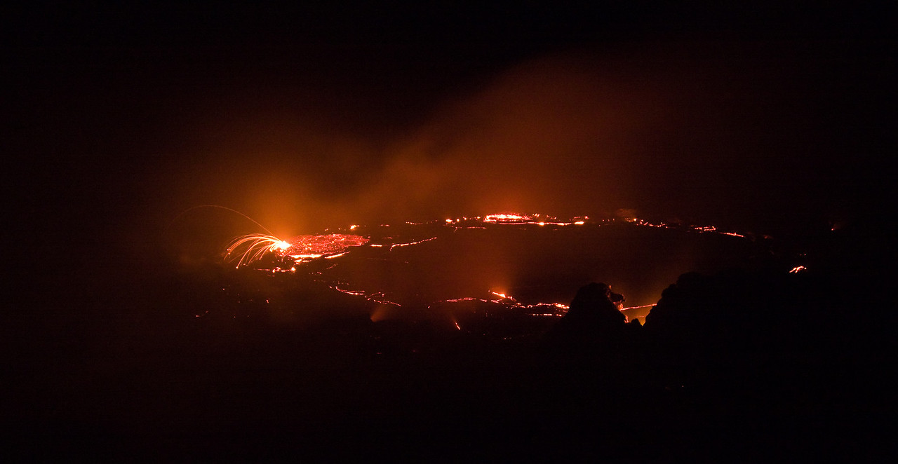 The primary lava lake inside the volcano.  <br /> <br /> Though I'm sitting just feet from the rim of the crater inside the main volcano caldera, probably only about 50 yards or less from the lava, I couldn't see a thing - my visit happened to be on a completely moon- and star-less night and as I didn't arrive at the summit of the volcano until after dark, I never got a chance to view (let alone photograph) my surroundings.  The only illumination, save from that of my headlamp, was the slowly convecting lava lake in front of me.<br /> <br /> Location: Erta Ale volcano, Denakil Depression, Ethiopia<br /> <br /> Lens used: 24-105mm f4.0 IS