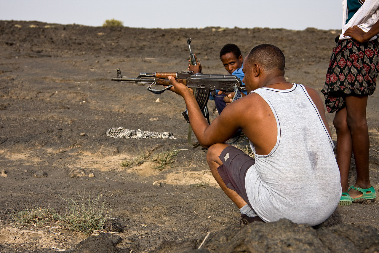 My driver, Weldu takes aim.<br /> <br /> Location: Denakil Depression, Ethiopia<br /> <br /> Lens used: 241-05mm f4.0 IS