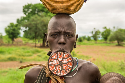 Woman from the african tribe Mursi with a big lip plate
