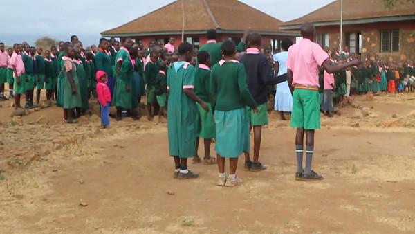 Amboseli School singing the Kenyan National Anthem