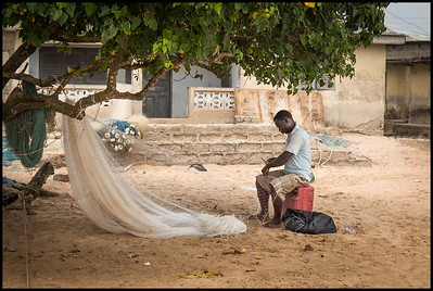 Preparing fishing nets, Busua