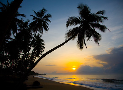 BRENU AKYINIM, GHANA - OCTOBER, 2006:  Sunset at the fishing village of Brenu-Akyinim is located 10 km west of Elmina and features a long palmfringed sandy beach often packed with fishermen and their boats.  ( Photo by: Christopher Herwig)