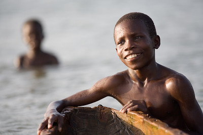 Young ghanian boy playing in water
