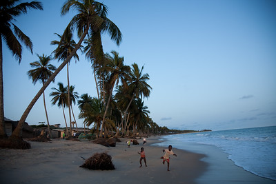 BRENU AKYINIM, GHANA - OCTOBER, 2006:  The fishing village of Brenu-Akyinim is located 10 km west of Elmina and features a long palmfringed sandy beach often packed with fishermen and their boats.  ( Photo by: Christopher Herwig)
