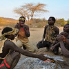Preparing for the morning hunt at a Hadzabe campsite. The Hadza, or Hadzabe are an ethnic group that lives near Lake Eyasi,and the nearby Serengeti plateau in North-Central Tanzania. The Hadzabe, a once numerous people in this area now  number only approximately 1000. About 400 of the Hadzabe still live their traditional hunter-gatherer lifestyle, and are considered the last full time hunter gatherer group in Africa today. Lake Eyasi, Tanzania