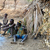 Making an arrow, an essential part of the lifestyle of a hunter gatherer group. Lake Eyasi, Tanzania